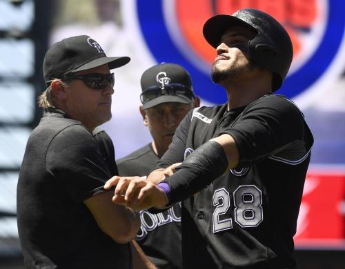Rockies' Nolan Arenado OK after getting hit by Cubs' Cole Hamels, but hard feelings linger