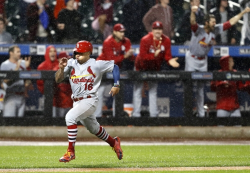 Cards rally in the rain before game is suspended in 9th at 4-4