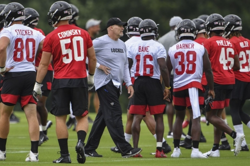 Dan Quinn getting used to balancing new duties at helm of Falcons defense