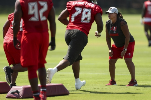 Tampa Bay Buccaneers assistant defensive line coach Lori Locust watches drills during organized training activities on May 28, 2019 at AdventHealth Training Center in Tampa, Fla.