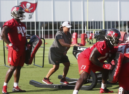 Tampa Bay Buccaneers assistant defensive line coach Lori Locust runs drills while standing on the sled during mandatory mini-camp on June 5, 2019 at the AdventHealth Training Center in Tampa, Fla.