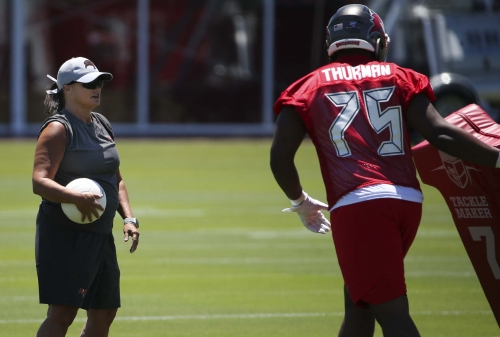 Tampa Bay Buccaneers assistant defensive line coach Lori Locust conducts a drill with what appears to be a volleyball while on the field with her team during the first day of Bucs practice on Tuesday, April 23, 2019 at One Buc Place in Tampa, Fla.