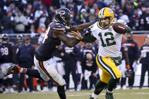 Chicago Bears outside linebacker Leonard Floyd (94) sacks Green Bay Packers quarterback Aaron Rodgers (12) near the end of the second half on Sunday, Dec. 16, 2018 at Soldier Field in Chicago.