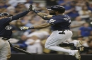 Brewers slip past Pirates 2-1 on Thames' homer in 8th