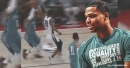Miles Bridges Eurosteps his way for the windmill dunk in Summer League