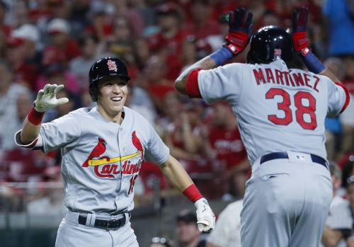 Edman's sixth-inning slam caps Cardinals rally against Reds