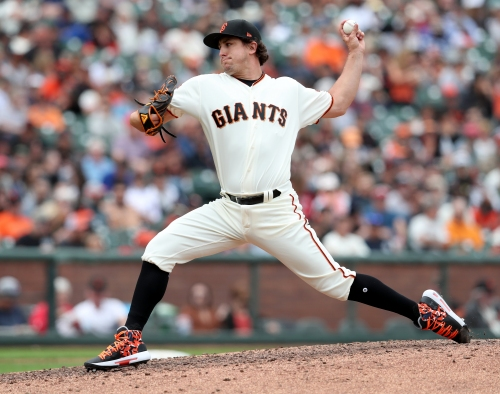 Giants designate Derek Holland for assignment