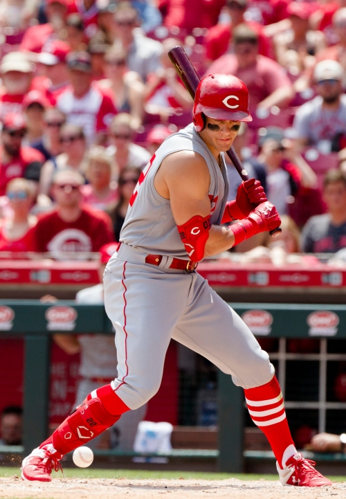 Reds players flex their sleeveless throwback jerseys