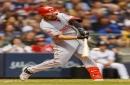 Eugenio Suárez bails out Raisel Iglesias in Cincinnati Reds' win over Milwaukee Brewers