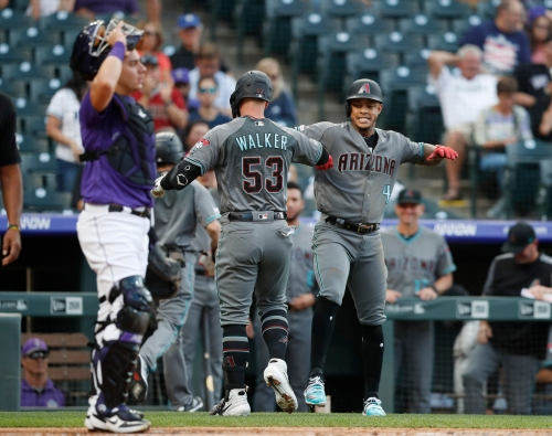 Diamondbacks club four homers in first two innings, cruise past Rockies