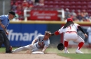 Edman lifts Cardinals, who hold on for a split in Cincinnati