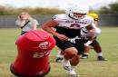 Antonio Pierce relates to ASU linebacker Merlin Robertson juggling football, fatherhood