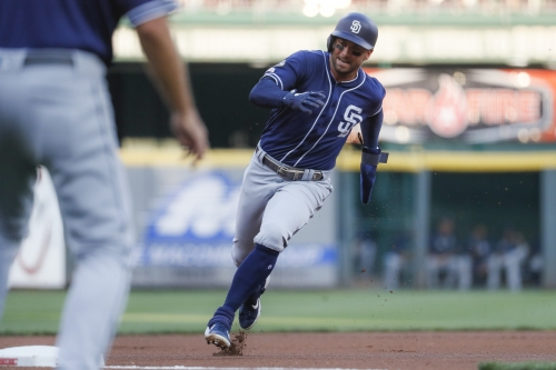 Padres strike out against Bauer, but strike enough to beat Reds
