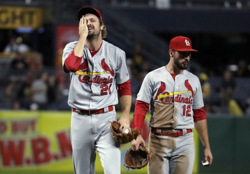 Pirates have big rally in 7th after misplay by Cards' DeJong at short