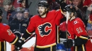 Frolik watching attentively as Flames piece intricate cap puzzle