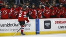 NHL Roundup: Hughes scores two, Capitals beat Blackhawks in OT