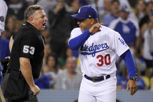 An ejected Dave Roberts erupts and Dodgers follow suit to rout Rockies