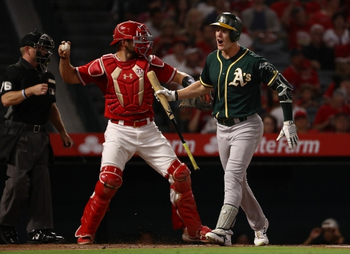 'It's always been tight, and it's going to continue to be tight': the wild card race gains speed in Athletics loss to Angels