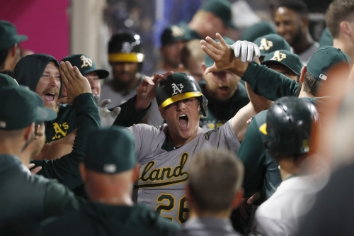 'To get the win and keep the lead in the wild card, everybody was pretty excited': Matt Chapman's ninth-inning homer seals Athletics win over Angels
