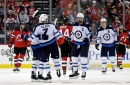 Jets rally from 4-goal deficit to stun Devils for 1st win of season