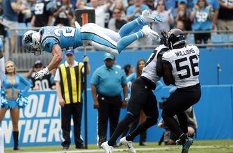 McCaffrey scores 3 TDs, Panthers hold off Jaguars 34-27