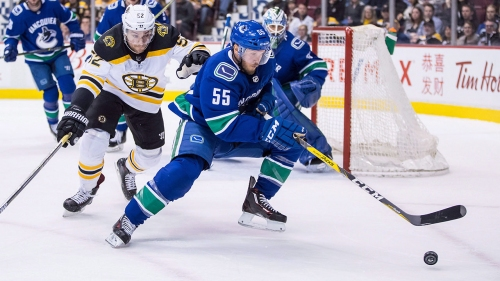 Canucks trade defenceman Alex Biega to Red Wings for forward David Pope