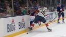 Islanders' Eberle forced to leave game late after getting hit into boards