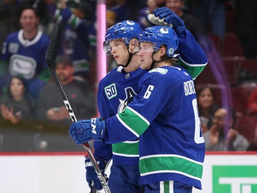 Potent power play pushes Canucks past Red Wings to stay perfect at home