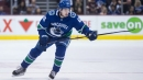 Canucks' Quinn Hughes skates, still day to day with bruised knee