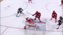 Red Wings' Bernier extends to rob Pastrnak of sure goal