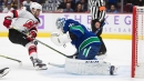 Devils score two quick goals, hold on to beat Canucks