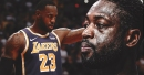 Dwyane Wade reacts to LeBron James' ferocious dunk during Lakers vs. Kings