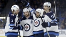 Stamkos scores his 400th goal but Jets top Lightning