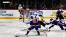 Evgeni Malkin falling to ice swats puck past Thomas Greiss