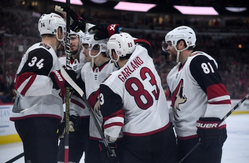 Coyotes rally from early two-goal deficit to beat Blackhawks in shootout