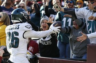 Wentz, Eagles keep NFC East hopes alive by beating Redskins