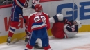 Tom Wilson smashes Jakob Lilja head first into end boards