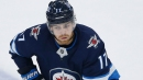 Jets' Adam Lowry leaves game vs. Blackhawks with upper-body injury