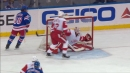 Jimmy Howard stretches across crease to rob Filip Chytil