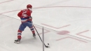 Evgeny Kuznetsov flips a backhand shot over the glove of Matt Murray