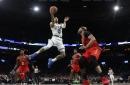 Celtics slip past the Hawks, 112-107