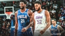 Joel Embiid stands with Karl-Anthony Towns as he deals with mom's health issues