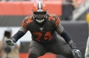 AP Source: Browns tackle Hubbard restructures contract