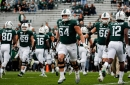 Michigan State football players find out brothers come in handy in workouts