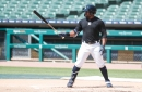 Detroit Tigers' Christin Stewart blasts one up the middle in scrimmage