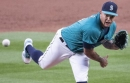 Photos: Mariners take on division rival Athletics in home opener