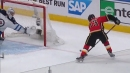 Johnny Gaudreau buries puck past Connor Hellebuyck from goal line