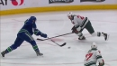 J.T. Miller drags and snipes off the post to give Canucks a lead