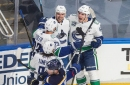 Canucks top defending champion Blues in Game 1