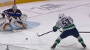 Bo Horvat scores five-hole in OT assisted by Quinn Hughes to win Game 2